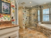 The frameless glass shower door enclosure