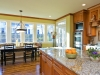 A bank of windows adds much to this remodeled kitchen